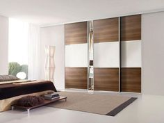 Modern closet door with options sliding closet doors wearing a brown color and white to allow opening and closing the door In order to be more easily Mirrored Bifold Closet Doors, Modern Closet Doors, Modern Sliding Doors, Sliding Closet Doors, Double Doors, Sliding Door Wardrobe Designs, Sliding Door Design, Wardrobe Design Bedroom, Closet Door Alternative
