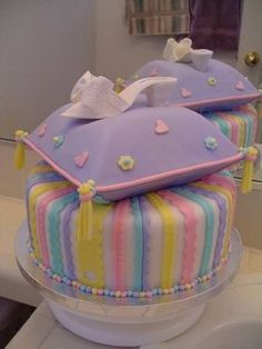 Princess birthday cake.  The shoe is hand sculpted from gumpaste and the childs name is written in the sole of the shoe.