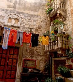 Charming Back Street with Hanging Laundry. Trogir, Croatia.