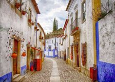 The medieval village is one of the most picturesque and well preserved in Portugal. Was once offered by a Portuguese King (Dinis I) to his wife. Portugal Places To Visit, Places To Go, Algarve, Travel Alerts, Nature Landscape, Portuguese Culture, Portugal Travel, Portugal Trip, Medieval Town