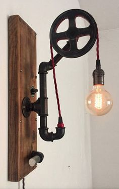 Vintage industrial wall plumbing pipes and old wood with red fabric braid cord pulley in mdf, possib Pipe Lighting, Rustic Lighting, Industrial Lighting, Vintage Lighting, Cool Lighting, Lighting Design, Lampe Edison, Lampe Tube, Industrial Light Fixtures