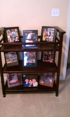 Changing Table used to display favorite Photos! Love this idea to recycle a changing table