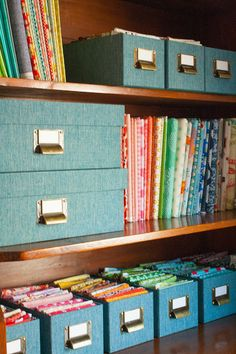 Fabric storage. Larger pieces of fabric are stored on comic book boards and sitting on the shelves like bolts of fabric in the store. Fat quarters are folded and stored in media (CD) boxes.