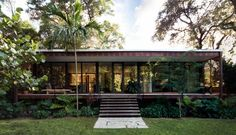 Brillhart House by Emma Janzen is part of Miami houses - Between the front and rear exteriors, over of patio space extend the living areas into the outdoors From this angle, the references to Florida cracker architecture are obvious Tropical Architecture, Architecture Photo, Glass Pavilion, Vernacular Architecture, Tropical Houses, Modern Tropical House, Future House, Outdoor Living, House Design