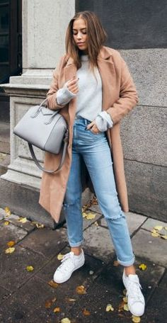 Kenza Zouiten + casual fall style + gorgeous camel overcoat + jeans + pair of white sneakers + laid back chic! Jeans: Asos, Coat: Make Way, Sweater: Ivy Revel, Coat: Make Way, Shoes: Adidas.