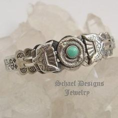 Fred Harvey Era Vintage Silver Coiled Snake with turquoise, thunderbirds & Hand Stamped Cuff Bracelet| online upscale native American jewelry boutique gallery| Schaef Designs Southwestern turquoise Jewelry | New Mexico by Fullgot