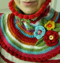 Dislike the colours, flowers and edging but the general idea would be good for kids who hate scarves