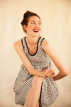 Red lipstick, a smile and a dotted dress