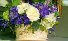 The backside of the Easter / Spring silk floral centerpiece I made. Arrangement includes tulips, hydrangeas,  ranunculus, roses, lilacs, freesias, delphiniums, viburnum & Easter eggs. Arrangement by Laurie Millet.
