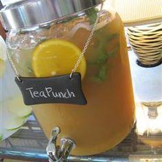 Tea Punch Original recipe makes 24 servings  1 cup white sugar  1 cup strong brewed black tea  4 cups orange juice  4 cups pineapple juice  4 cups prepared lemonade  1 (2 liter) bottle ginger ale, chilled