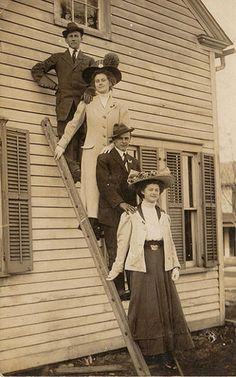 """Ah, yes. The good old """"standing on a ladder"""" group shot. In period clothing. Who DOESN'T have one of those?"""