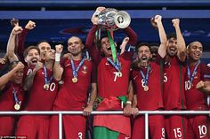 Portugal's captain and forward Cristiano Ronaldo holds up the winners' trophy in the Euro ...
