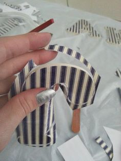 The secret tool to use while putting scrapbook paper onto wooden letters is a............................NAIL FILE!