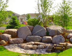 Boulder Images create a backyard fire pit for your outdoor living environment. Located close to Minneapolis we service Minnesota and Wisconsin. Easy Fire Pit, Small Fire Pit, Landscaping With Boulders, Backyard Landscaping, Backyard Seating, Landscaping Ideas, Minnesota Landscaping, Boulder Retaining Wall, Retaining Walls