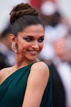 Deepika Padukone, the Indian actress, dazzled in a dark green Brandon Maxwell gown with a thigh-high split and a de GRISOGONO white gold diamond earrings and a high jewellery bracelet in white gold set with diamonds and emeralds. For glamour celebrity fashion Cannes Film Festival red carpet jewellery spotting travel here: http://www.thejewelleryeditor.com/jewellery/top-5/cannes-film-festival-red-carpet-jewellery-day-two/ #jewelry