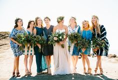 indigo bridesmaids with flower crowns by the ocean - beautiful!