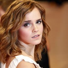 Emma Watson - Medium Wavy Hair Love the short layers around the face, will be great for growing out my bangs