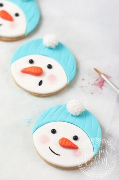 How to make and decorate festive snowman cookies for Christmas