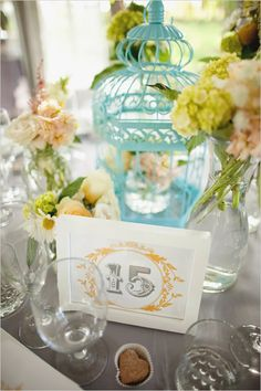 free printable table number. Also love the birdcage and the flowers!
