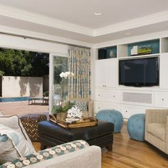 Like the built-ins for the TV, Ceilings. San Carlos Residence Two - contemporary - family room - san francisco - Amoroso Design Glass Door Curtains, Window Curtains, San Francisco, Living Room Essentials, House Of Turquoise, Turquoise Accents, Sliding Glass Door, Glass Doors, Sliding Doors