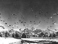 World War 2 paratroopers landing on dropzone