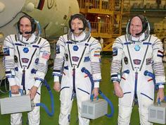 MISSION SPACE!!!    Donald Pettit, Oleg Kononenko and Andre Kuipers stand in their spacesuits at the Soyuz TMA-03M space craft