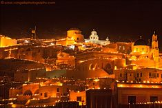 Easter in Pyrgos village, Santorini. The village's boys prepare torches and light thousands of candles on all the terraces, creating this mystical atmosphere.