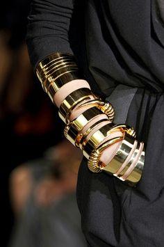 Gold bracelets.