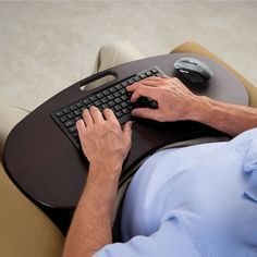 The Wireless Lap Desk Keyboard - Hammacher Schlemmer - This is the lap desk with a built-in wireless keyboard that allows users to type on a computer from wherever they feel most comfortable. A USB radio transmitter connects a computer wirelessly to the integrated full-size keyboard and included wireless mouse from up to 30 feet away.
