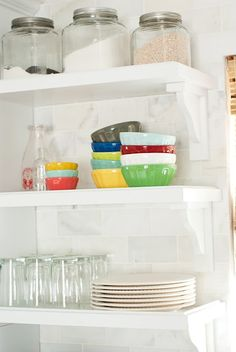 I like this style of open shelves and supports for everyday ware near the sink.
