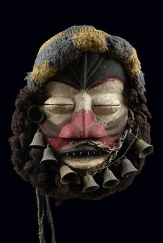 """Côte d'Ivoire, Ngere wood, polychrome paint, fabric, metal, almond-shaped eyes with small see slits, dominated by a broad mouth with full lips and metal teeth, attached bells, metal chains and a beard made from real hair, collection number on the back """"No 42 Gueré"""", min. dam., slight traces of abrasion  H: 23 cm H: 9.1 inch ProvenanceColl. Kröner, Gerlingen, Germany Literature  Boyer, Alain-Michel, Girard, Patrick u.a., Arts premiers de Côte d' Ivoire, Sepia 1997, p.  Read more: http://ww"""