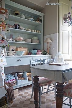would love an old cupboard like that! Though I can image the dust that settles in an open cupboard like this one if you don't clean it too much =)
