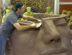The life size and larger figurative sculptures are made with an architectural red stoneware. It is a heavily grogged clay body specifically designed for use in making exterior architectural ornamentation. The sculptures are all hand built, one of a kind pieces. They are constructed hollow, with a wall thickness averaging 3\4 of an inch. This makes them heavy but it also makes them exceptionally strong, and durable.