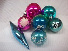 This lot of 7 glass ornaments would be a great addition to your aluminum tree or for retro crafting. They are marked USA, Poland and West Germany and show age related wear.  The 3 large balls are 2 3/4. The 3 smaller ones are 2 1/4 The teardrop is 6 including the hanger.  These will ship First Class to save on cost.  Please check my other listings for more vintage Christmas items. I am happy to combine shipping.  THE FINE PRINT: Shipping cost stated is for the West Coast. If you are...