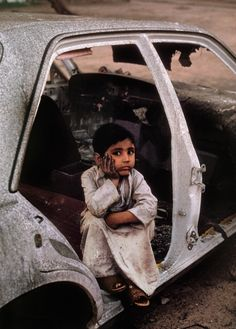 Kuwaiti boy during Iraqi invasion in Kuwait in 1991 ... so young to look so forlorn