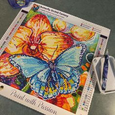 """Did you know that butterflies taste with their feet? This Orchid is the perfect snack for this beautiful butterfly's liquid diet! Currently on SALE 🦋 """"Butterfly Orchid Fantasy"""" by Sandra Trubin 30x30 Square with 39 colors including 2 AB 📸 @terichauza Glow Effect, Diamond Paint, Liquid Diet, Beautiful Butterflies, Canvas Material, The Dreamers, Color Blocking, Orchids, Fantasy Art"""