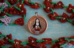 """Saint Therese of Lisieux devotional medal. 7/8"""" across.  Created by Diddy Wa Diddy"""