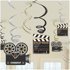 "Lights,Camera,Action Decor by AMSCAN *. $5.07. Includes one package of 12.. Bring out the stars for your Hollywood party! Lights, Camera, Action Hanging Swirl Decorations feature a myriad of silver, gold and black foil swirls some with clapboard and movie camera cutouts attached. Pack includes 6 swirl decorations (18"") and 6 sw"