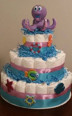 Purple and blue Octopus Diaper Cake. Under the sea theme. Free Shipping. Fun centerpiece, three tier diaper cake by MyJoyfulTiers on Etsy