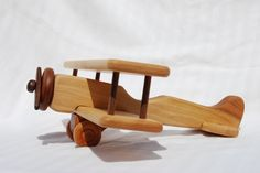 Large Wooden Biplane Airplane Toy or Mobile by AHigherPlaneDesigns, via Etsy.