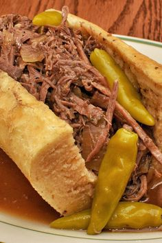 Easy 5 Ingredient Slow Cooker Original Italian Beef Sandwiches Recipe with Italian Salad Dressing Mix and Pepperochini Peppers - 5 Minute Prep Time