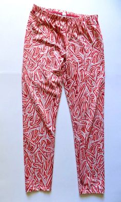 Thanks for looking, follow me Pinterest @Salesfortoday for daily updates on new items and sales.  Brand: The Children's Place  Type: Full Length Leggings  Size: Girls 10-12 Large L  Color: Red & White Candy Cane Print  Features: 88% Polyester 12% Spandex, Machine Washable, Full Length, Elastic waistband  Condition: Good pre-owned condition, no holes, no tears, no stains, tons of life left. No fading either. Great leggings for everyday wear, school, candy theme occassion, or for the upcoming