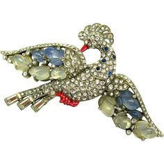 Exquisite and rare Alfred Philippe for Trifari 1941 'Fruit Salad Peacock' brooch designed in rhodium plated metal.  This magnificent bird in flight