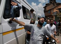 An unidentified relative of Riyaz Ahmad Shah, one among two civilians killed by government forces wails as an ambulance carrying his body arrives at…