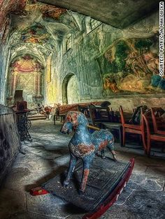 Polish photographer Patrycja Makowska takes incredibly detailed shots of ruined buildings but refuses to divulge their location.  Another room, another abandoned object. This time a mottled old rocking horse in what perhaps could have been a very ornate nursery.