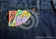 Australian money in the front pocket of a pair of jeans, $100, $50, $20 and $5.00 notes. Copyspace.