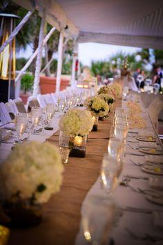 white flowers + burlap runner wedding tablescape