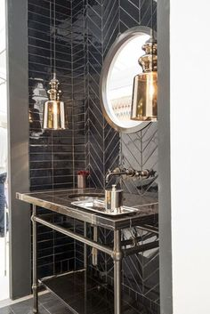 The black tiles and metal accents make this industrial powder room look chic Bad Inspiration, Bathroom Inspiration, Chevron Tile, Herringbone Tile, Black Chevron, Black Tiles, Black Marble, Black White, Small Bathroom