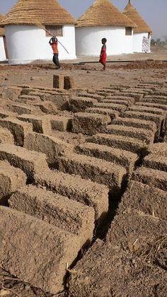 Hand - made mud bricks, Mali, Africa.