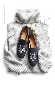 The best gifts consist of something both practical and unexpected, like this gift pairing. Give her the gift of cozy with a warm mixed stitch turtleneck pullover sweater that she can wear all winter long and pair it with playful graphic print statement loafers. The animal graphic is on trend this season, and the smoking loafers truly adds the special touch that makes this the best kind of gift, something she loves but might not buy for herself.